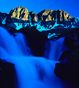 Blue waterfall beneath the mountains.