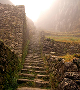 Andean stone steps leading upwards into the mist.