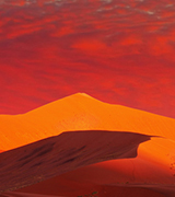 Namib desert dunes at sunset.
